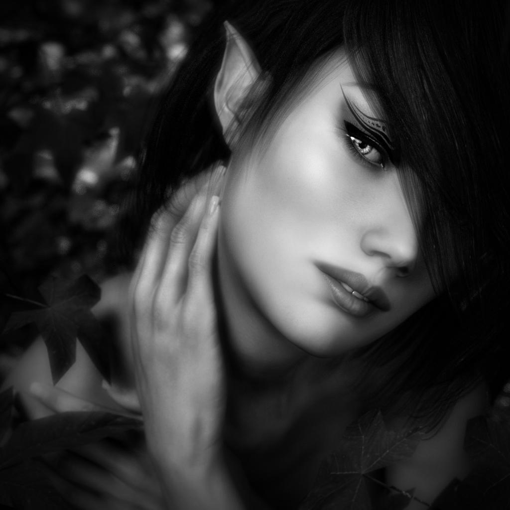 Balck and White portrait of a woodland elf amongst leaves.